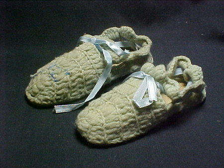 A pair of crocheted slippers made by First Lady Ida McKinley. Crocheting was a hobby for Mrs. McKinley and it is estimated that she crocheted 4,000 slippers for many people including family, friends, orphans and Civil War veterans. Union veterans received blue slippers and Confederate veterans received gray slippers.